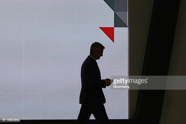 The silhouette of Rupert Stadler chief executive officer at Audi AG is seen on stage during an opening ceremony for the company's new production...