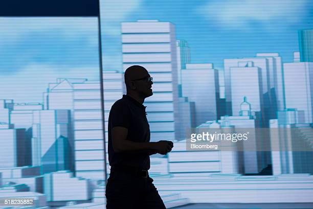 The silhouette of Satya Nadella chief executive officer of Microsoft Corp is seen as he speaks during a keynote session at the Microsoft Developers...