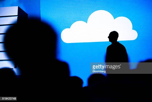 The silhouette of Scott Guthrie executive vice president of the cloud and enterprise group at Microsoft Corp is seen as he speaks during a keynote...