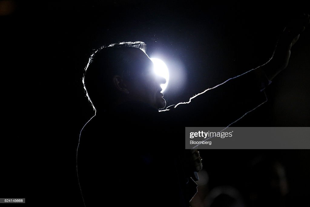 The silhouette of Senator Ted Cruz, a Republican from Texas and 2016 presidential candidate, is seen speaking during a campaign event in Borden, Indiana, U.S., on Monday, April 25, 2016. Cruz won the majority of delegates that the Utah and Maine parties voted to send to July's convention, another victory for the Texas senator's organizational efforts over front-runner Donald Trump that could bolster Cruz at a contested convention. Photographer: Luke Sharrett/Bloomberg via Getty Images