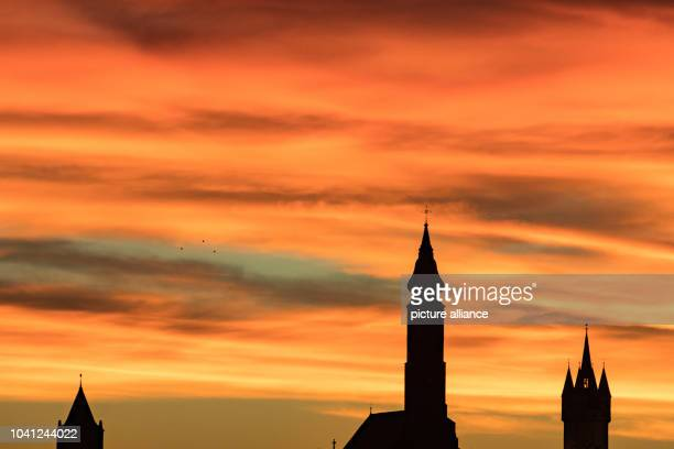The silhouette of Straubing with the water tower , the Basilika St. Jakob and the city tower Stadtturm pictured at sunrise on 22 November 2016....