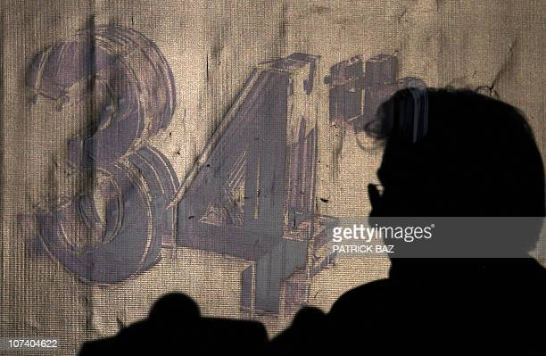 The silhouette of US Hollywood movie star Richard Gere appears near the logo of the 34th Cairo International Festival during a press conference in...