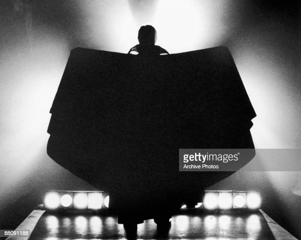 The silhouetted figure of the vampire Count Dracula raising his cape in batlikefashion circa 1970