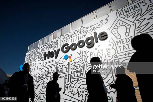 The silhouettes of attendees are seen at the Google Inc booth during the 2018 Consumer Electronics Show in Las Vegas Nevada US on Thursday Jan 11...