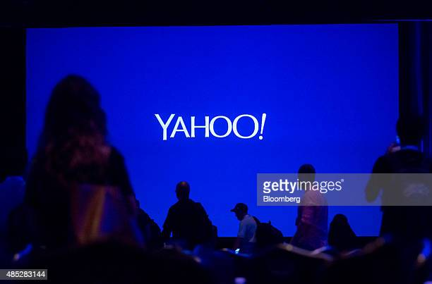 The silhouettes of attendees are seen before the start of the Yahoo Inc Mobile Developer Conference in New York US on Wednesday Aug 26 2015 The...