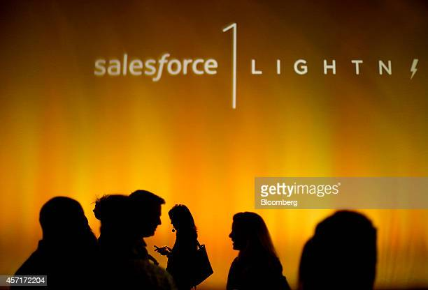The silhouettes of attendees are seen during the DreamForce Conference in San Francisco, California, U.S., on Monday, Oct. 13, 2014. Salesforce.com...