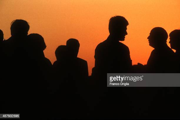 The silhouettes of Japanese Prime Minister Tomiichi Murayama European Commission President Jacques Delors French President Francois Mitterrand...