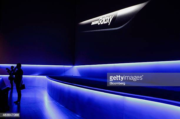 The silhouettes of members of the media are seen during the Samsung Electronics Co Unpacked 2015 event in New York US on Thursday Aug 13 2015 Samsung...
