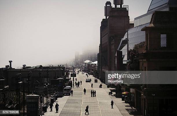 The silhouettes of pedestrians are seen walking as a fog moves in along the boardwalk in Atlantic City New Jersey US on Monday May 2 2016 Atlantic...