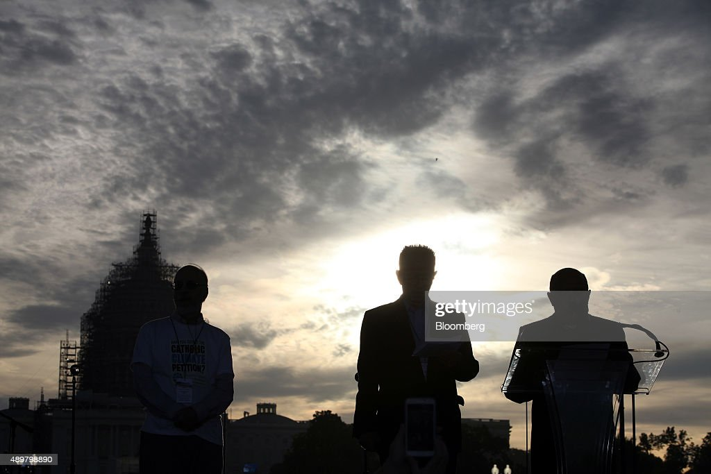 The silhouettes of speakers are seen addressing the crowd during the Moral Action on Climate Justice rally on the National Mall in Washington, D.C., U.S., on Thursday, Sept. 24, 2015. 'Climate change is a problem which can no longer be left to a future generation, Pope Francis said at the White House yesterday. Photographer: Oliver Contreras/Bloomberg via Getty Images