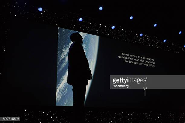 The silhoutte of General John Hyten commander of United States Air Force Space Command is seen during a presentation at the 32nd Space Symposium in...