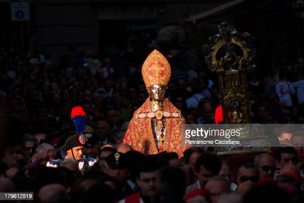 """The silver bust of San Gennaro is carried in procession among a crowd of worshippers in May's first Sunday celebration of the """"Blood Miracle"""""""