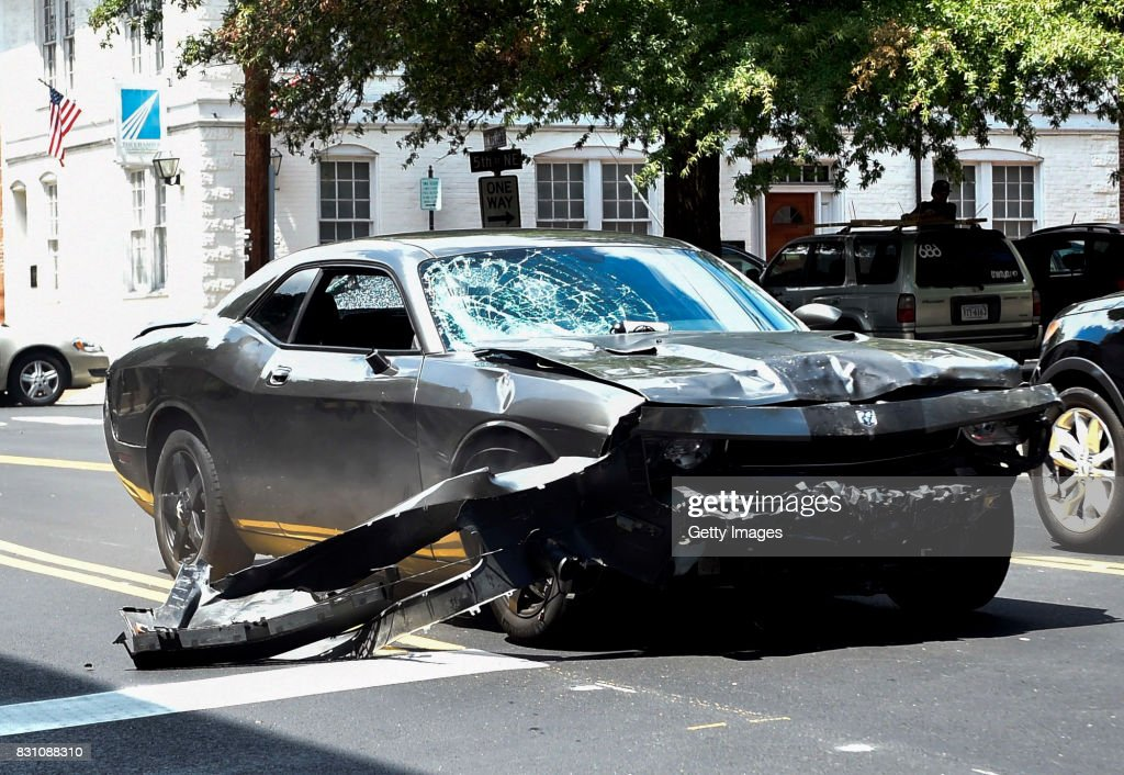 The silver Dodge Charger alledgedly driven by James Alex Fields Jr. passes near the Market Street Parking Garage moments after driving into a crowd of counter-protesters on Water Street on August 12, 2017 in Charlottesville, Virginia. Heather Heyer, 32 years old, was killed and 19 others injured when they were struck by Fields' car.