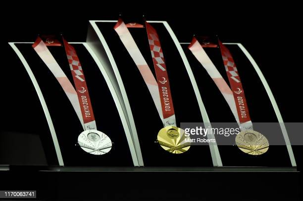 The silver, gold and bronze medals are displayed on stage during the Count Down Ceremony of the Tokyo 2020 Paralympic Games One Year To Go at the NHK...