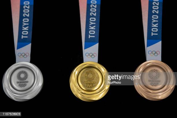 The silver gold and bronze medals are unveiled in the Tokyo 2020 medal design unveiling ceremony during Tokyo 2020 Olympic Games quotOne Year To...