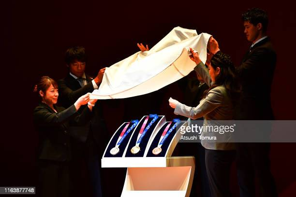 The silver gold and bronze medals are unveiled in the Tokyo 2020 medal design unveiling ceremony during Tokyo 2020 Olympic Games One Year To Go...