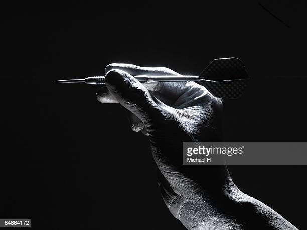 The silver hand which gives up a dart