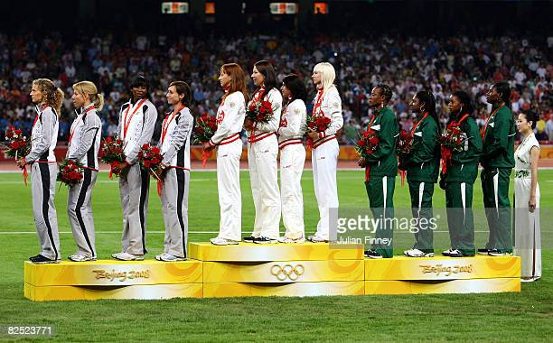 The silver medal team of Belgium, the gold medal team of Russia and the bronze medal team of Nigeria during the medal ceremony for the Women's 4 x...