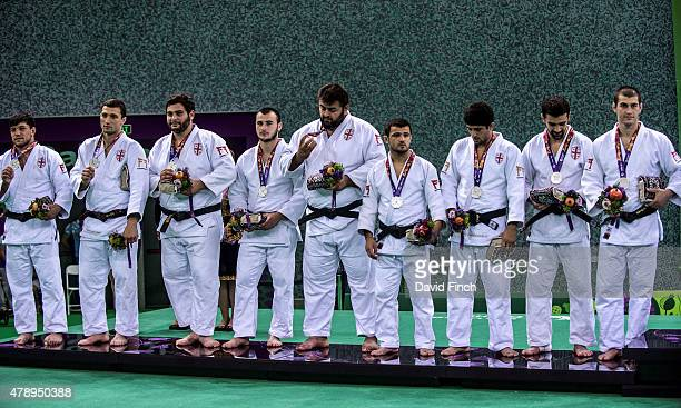 The silver medal winning Georgian men's team consisting of Beka Gviniashvili, Varlam Liparteliani, Ushangi Margiani, Levani Matiashvili, Adam...