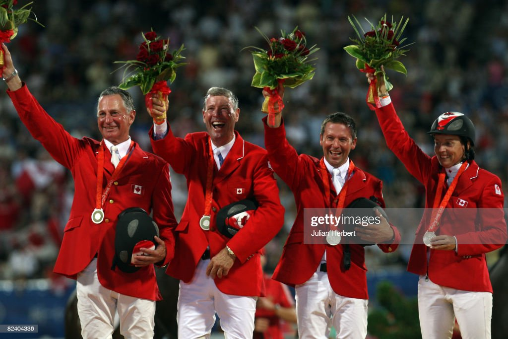 The silver medal winning team from Canada (L-R) Mac Cone, Ian Millar,Eric Lamaze,Jill Henselwood celebrate after the Team Jumping Competition held at the Hong Kong Olympic Equestrian Venue in Sha Tin during day 10 of the Beijing 2008 Olympic Games on August 18, 2008 in Hong Kong, China.
