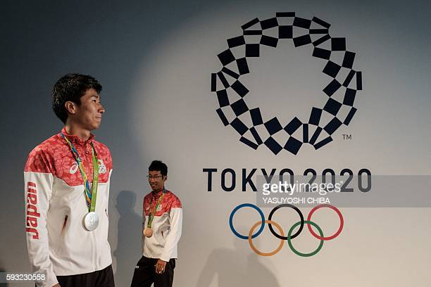 The silver medalist of Men's 4 x 100m Relay Yoshihide Kiryu and the bronze medalist for the men's 50km race Hirooki Arai walk after Japanese Prime...