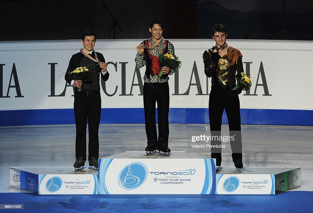 The Silver medalist Patrick Chan of Canada, the Gold medalist Daisuke Takahashi of Japan and the Bronze medalist Brian Joubert of France pose on the Podium in the Men Free Skating during the 2010 ISU World Figure Skating Championships on March 25, 2010 in Turin, Italy.