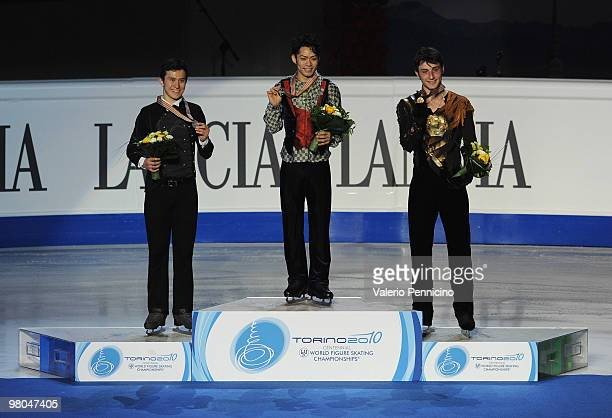 The Silver medalist Patrick Chan of Canada the Gold medalist Daisuke Takahashi of Japan and the Bronze medalist Brian Joubert of France pose on the...