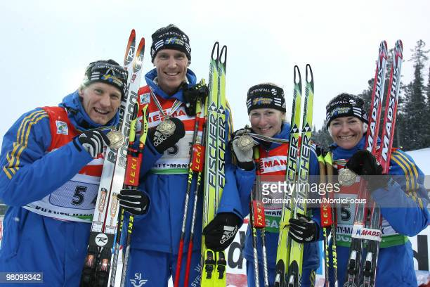 The silver medallists Carl Johan Bergman Bjoern Ferry Helena Jonsson and Anna Carin OlofssonZidek of Sweden show their medal after the relay mixed in...
