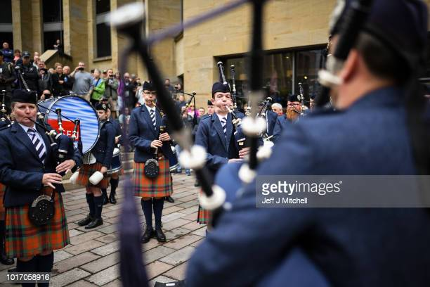 Scots College Pipes and Drums from Sydney Australia play in Buchanan street during the Piping Live Glasgow International Piping Festival on August 15...