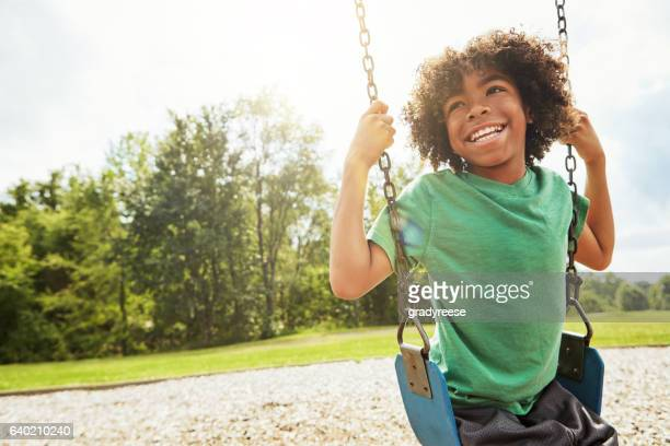 the simple joys of childhood - swinging stock pictures, royalty-free photos & images