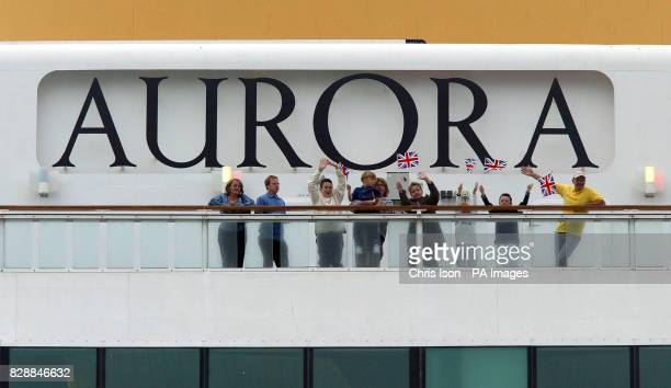 The Simpson family from Manchester wave to the media before disembarking from PO's flagship Aurora in Southampton Their 17day cruise around the...