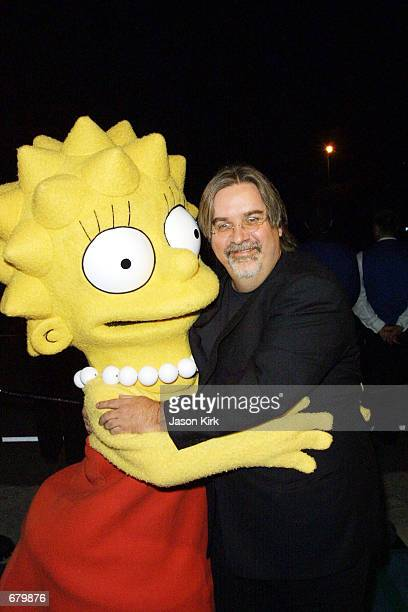 The Simpsons animated television show creator Matt Groening poses with character Lisa Simpson at the 11th Annual Environmental Media Awards at the...