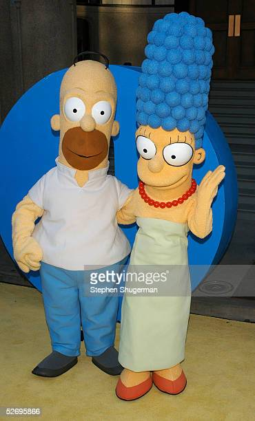 'The Simpsons' characters Homer and Marge Simpson attend 'The Simpsons' 350th episode block party on the New York street of Fox Pico Lot on April 25...