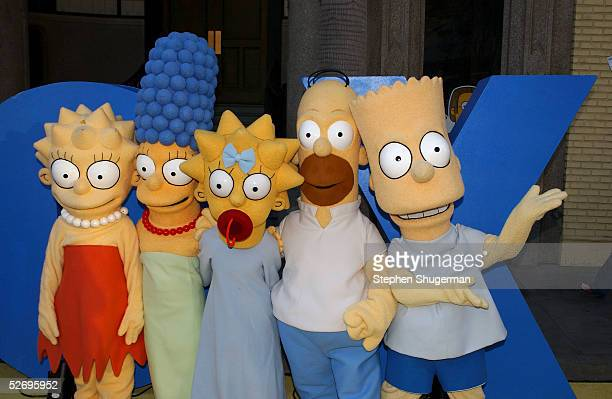 The Simpsons characters Lisa Marge Maggie Homer and Bart Simpson attend 'The Simpsons' 350th episode block party on the New York street of Fox Pico...