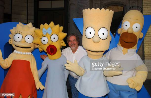 'The Simpsons' creator/executive producer Matt Groening poses with characters Lisa Maggie Bart and Homer at 'The Simpsons' 350th episode block party...