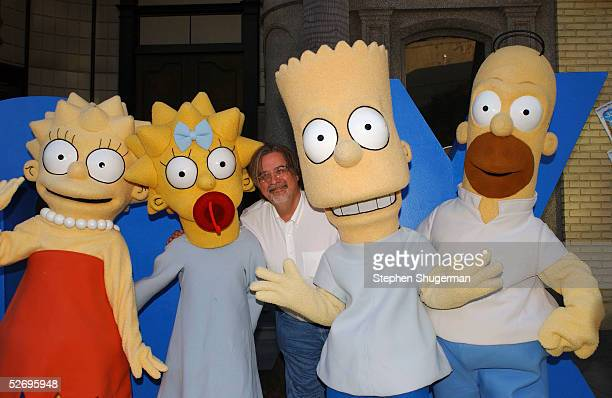 The Simpsons creator/executive producer Matt Groening poses with characters Lisa Maggie Bart and Homer at The Simpsons 350th episode block party on...