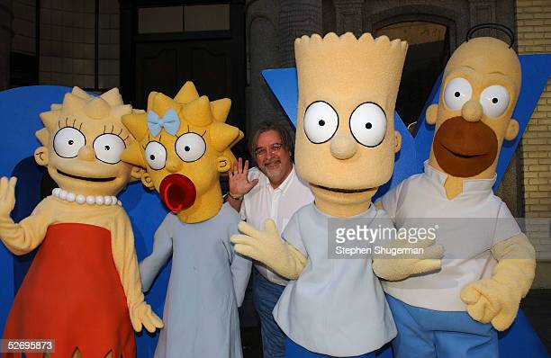 The Simpsons creator/executive producer Matt Groening poses with The Simpsons characters Lisa Maggie Bart and Homer at The Simpsons 350th episode...