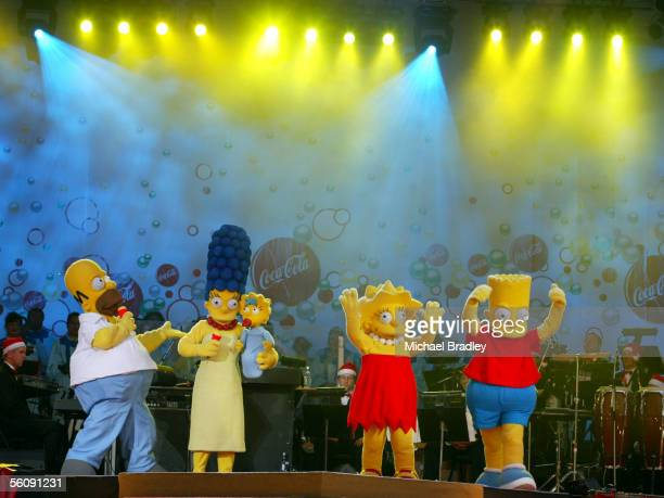The Simpsons entertain the crowd at the Coca Cola Christmas in the Park Saturday