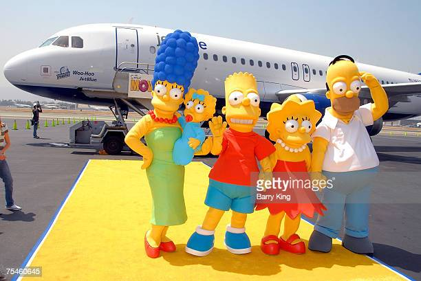 The Simpsons family members Marge Maggie Bart Lisa and Homer Simpson attending the JetBlue Airways Unveiling of Simpsons aircraft to celebrate...