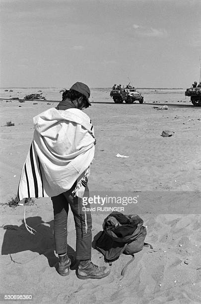 The Sinai desert in the Yom Kippur war Moving toward the Suez Canal early one morning I saw this soldier get out of his vehicle and put on his...