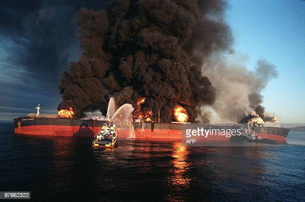 The Singapore flagged 85thousand ton Norman Atlantic stands ablaze 06 December 1987 after she was attacked by an Iranian warship in Omani territorial...