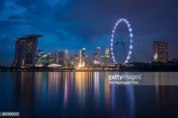 The Singapore Flyer a giant Ferris wheel that was at one time the worlds tallest is seen downtown as the sunsets across the Marina Bay from the...