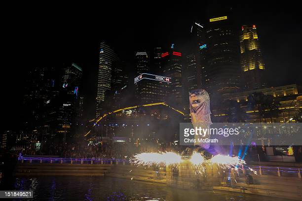 The Singapore Merlion is lit up with fireworks and projected light patterns in the Merlion and I An Inspiring Journey light show during the Merlion's...