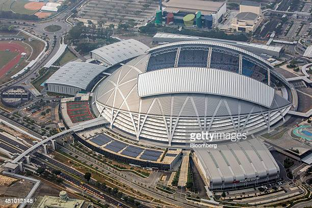 The Singapore National Stadium stands at the Singapore Sports Hub in the Kallang basin area in this aerial photograph taken above Singapore on...
