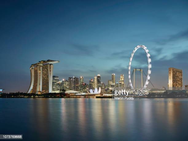 the singapore skyline and financial district at dusk, elevated view - singapore flyer stock photos and pictures