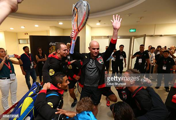 The Singapore Slammers practice in the locker room corridor how they are going to introduce Andre to the crowd before his match against Mark...