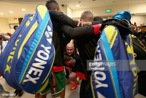 The Singapore Slammers practice in the locker room corridor how they are going to introduce Andre Agassi to the crowd before his match against Mark...