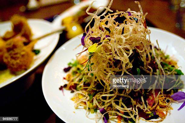 The Singapore slaw with salted plum dressing is arranged for a photo at Shang in New York US on Friday Jan 30 2009 Shang is located in the Lower East...