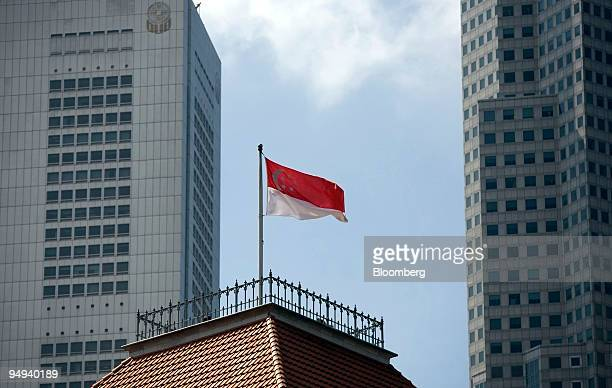 The Singaporean national flag stands against the commercial buildings in the financial district of Singapore on Wednesday Jan 21 2009 Singapore said...