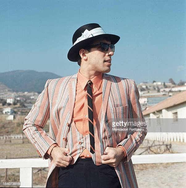 The singer Adriano Celentano with a hat in an outside shooting during his participation in the Festival of Sanremo Italy 1968